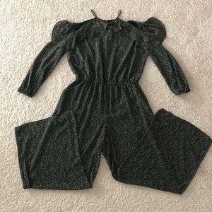 Long Sleeved, wide-legged Michael Kors jumpsuit.